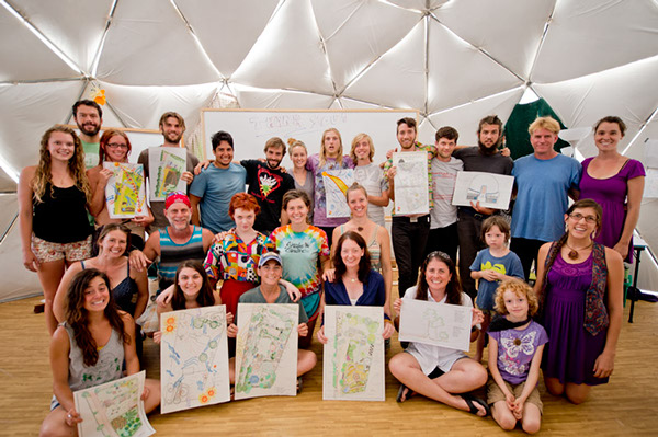 Students holding their final designs, from our intensive course last year, 2014. Photo credit-Woody Welch