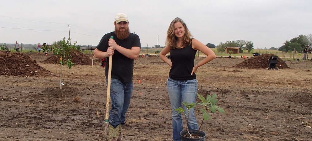 Cameron and Emily of Coyote Creek Farm Planting a Fig Tree at the Sept. Permablitz